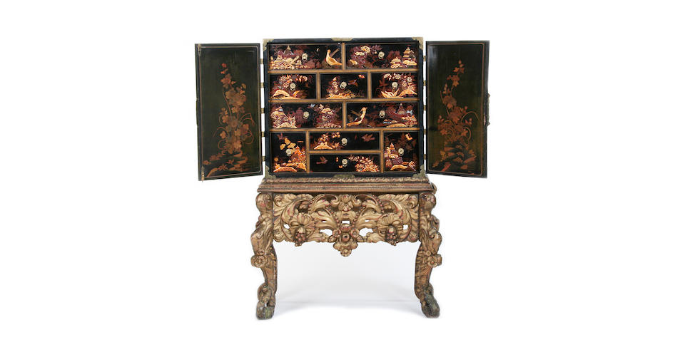 A black and gilt japanned cabinet on giltwood stand