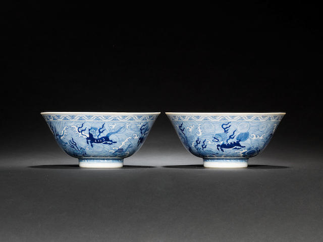 A pair of blue and white 'mythical beasts' bowls Daoguang seal marks and of the period