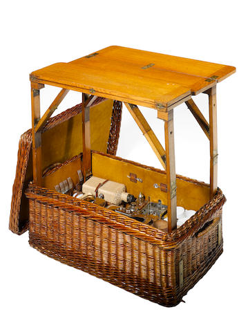 A superb six person wicker picnic set with built-in table, by G.W. Scott & Sons, 1907,