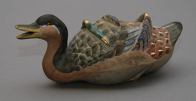 A Chinese duck sauce tureen