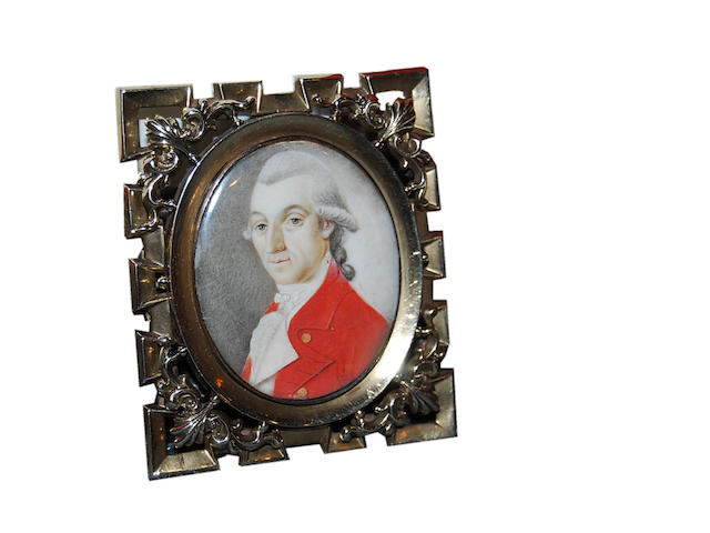 English School, circa 1785  A Gentleman, wearing red coat with gold buttons over cream waistcoat and frilled white cravat, his powdered hair worn en queue