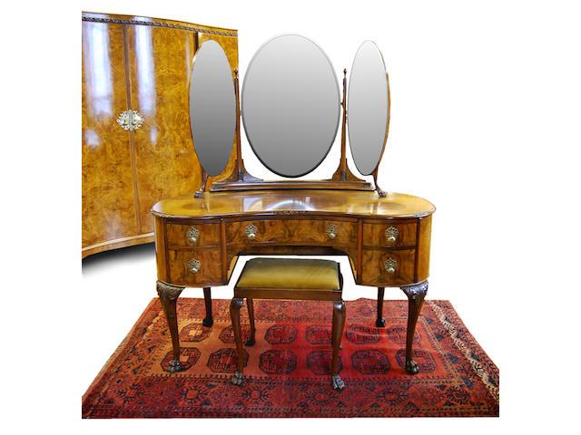 A four-piece figured walnut bedroom suite, 20th Century
