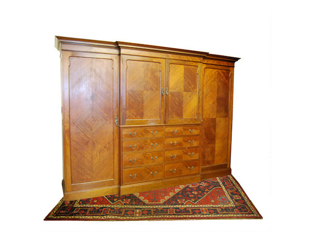 A large mahogany and inlaid breakfront combination wardrobe, early 20th Century Bearing label 'Manufactured by James Parkinson, 34 Clarence Street, Liverpool'