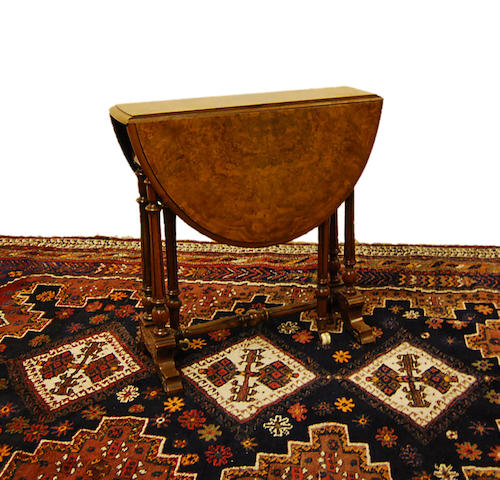A small late Victorian figured walnut Sutherland table