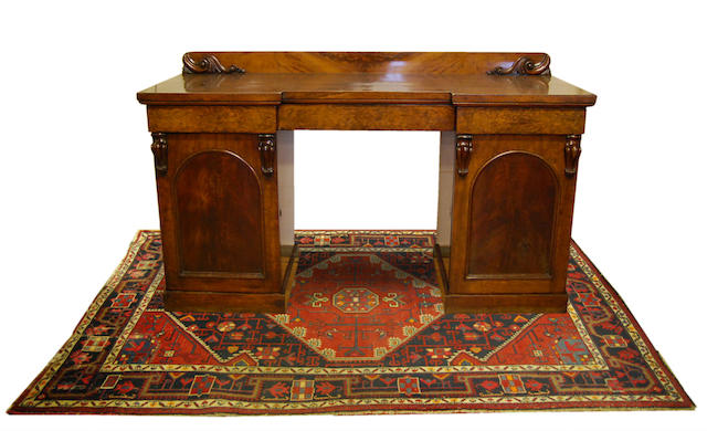 An early Victorian mahogany inverted breakfront pedestal sideboard
