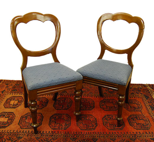 A set of eight Victorian mahogany balloon-back dining chairs