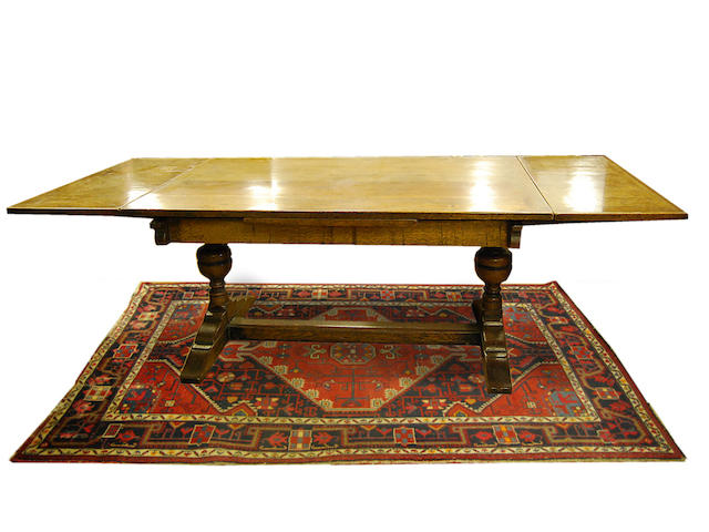 An oak draw-leaf 'refectory'-type table, 20th Century