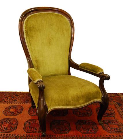 A Victorian mahogany-framed spoonback open armchair