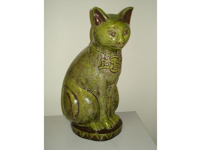 Ewenny Pottery: A model of a cat, signed and dated 1908.