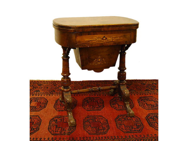 A Victorian walnut and inlaid work and games table