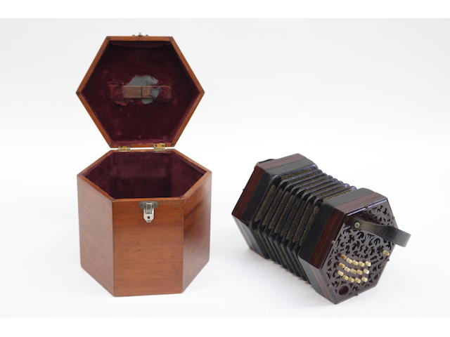 A mahogany cased concertina,