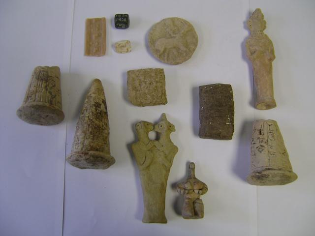 A group of Ancient Near Eastern artefacts and three other Near Eastern-style terracotta items 11