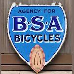 An 'Agency For BSA Cycles' double-sided shield-shaped enamel sign,