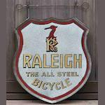 A 'Raleigh - The All Steel Bicycle' double-sided acid-cut back-painted glass shield-shaped sign, c1930,