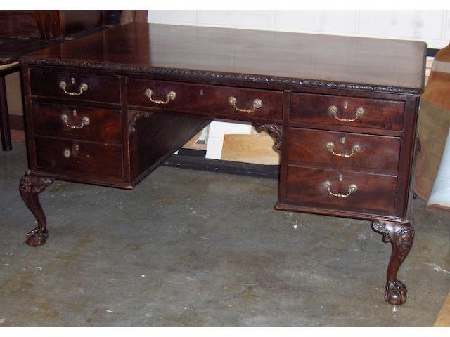 A reproduction Chippendale style mahogany partners desk,
