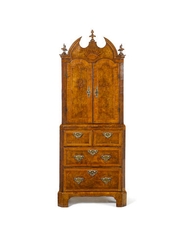 A rare George I walnut crossbanded and featherbanded Minature Cabinet