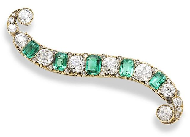 A late 19th century emerald and diamond brooch,