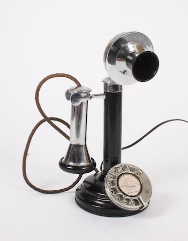 A replica candlestick telephone