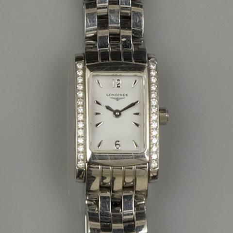 Longines: A lady's diamond set wristwatch