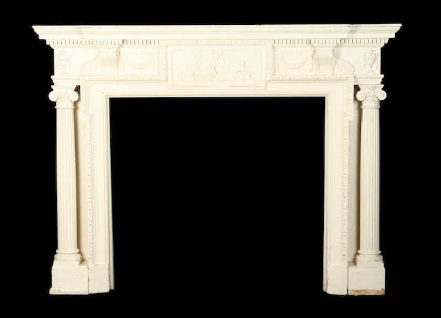 A late 19th century painted and carved pine chimneypiece