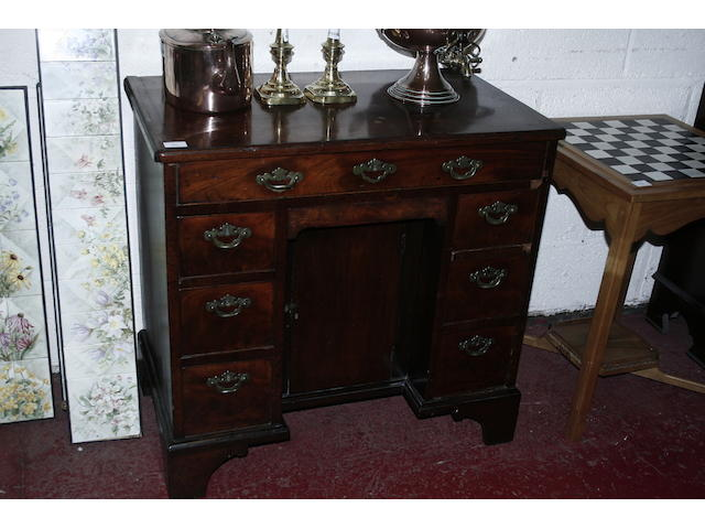An 18th century mahogany kneehole desk
