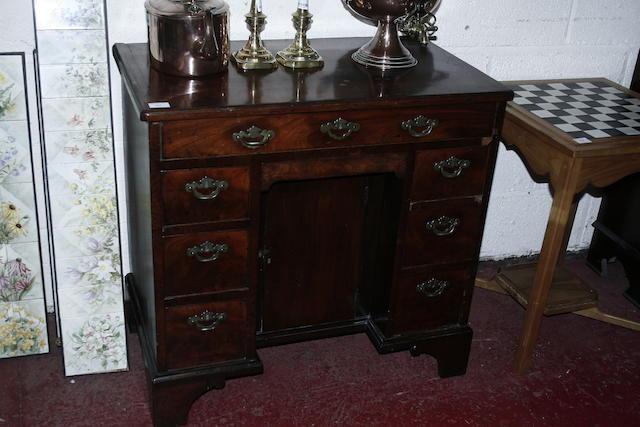 An 18th century mahogany kneehole desk