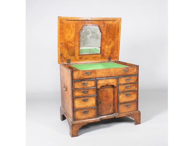 A George II figured walnut and herringbone banded kneehole desk/dressing table