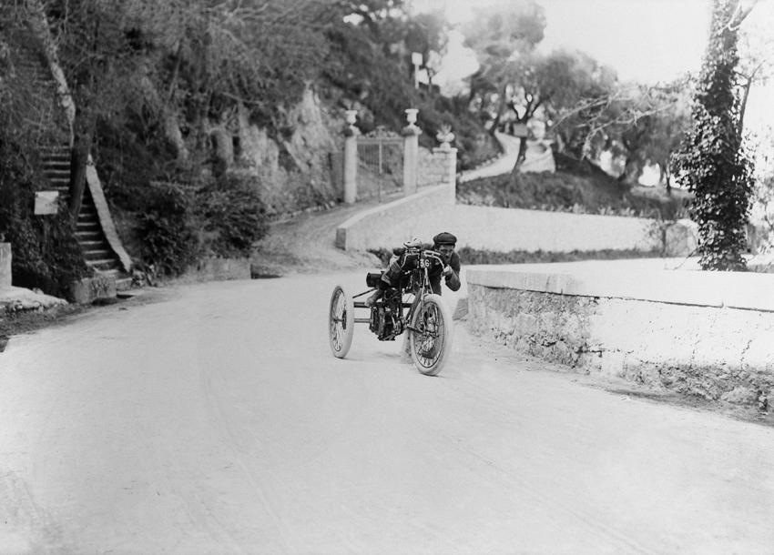 A limited edition monochrome photograph depicting an early racing Mors,