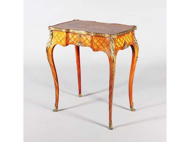 An early/mid-Victorian Louis XV style kingwood, walnut, marquetry, parquetry panelled and gilt brass mounted work type table in the manner of Holland and Sons