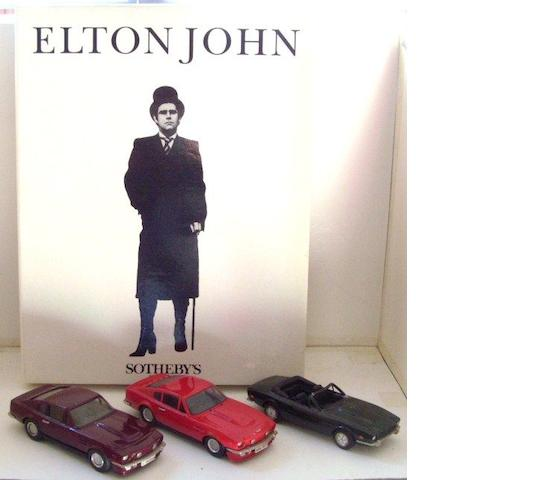 Three Aston Martin models, formerly the property of Elton John,