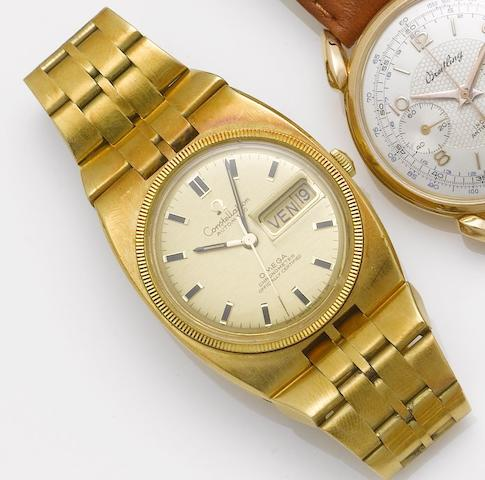 Omega. An 18ct gold automatic chronometer centre seconds calendar bracelet watchConstellation, 1960's