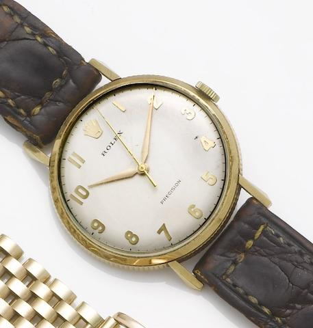 Rolex. A 9ct gold centre seconds wristwatch together with fitted boxLondon Hallmark for 1968
