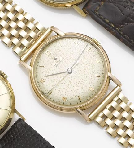 Rolex. A 14ct gold centre seconds watch together with a 9ct gold bracelet Case No.273782, Ref:4222, 1940's