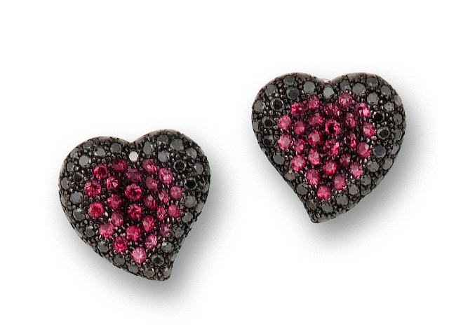 A pair of black diamond and pink sapphire earrings