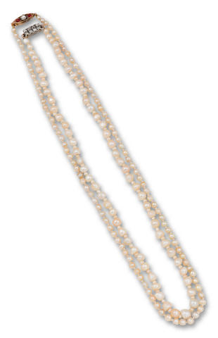 Two natural pearl necklaces with gem-set clasps (2)