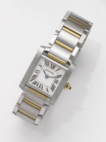 Cartier. A lady's stainless steel and gold bracelet watchTank, Recent