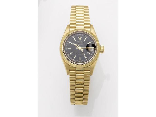 Rolex. A lady's 18ct gold automatic centre seconds calendar bracelet watchDatejust, 1989