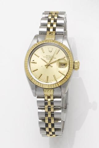 Rolex. A lady's stainless steel and gold automatic centre seconds calendar bracelet watch together with fitted box and papers Date, Made in 1983, Sold December 13th 1983