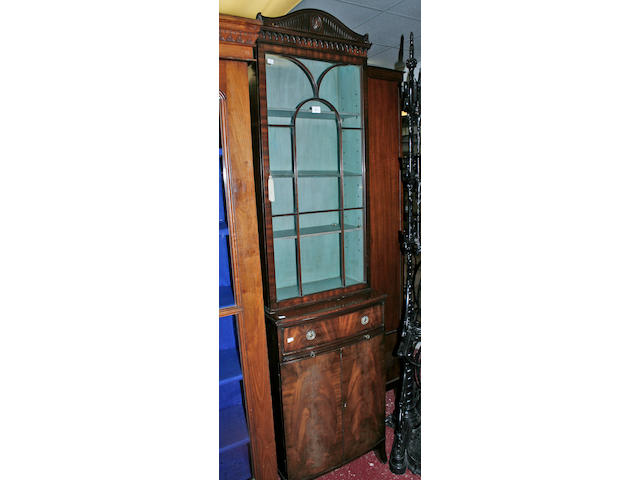 A good quality reproduction mahogany cupboard bookcase,