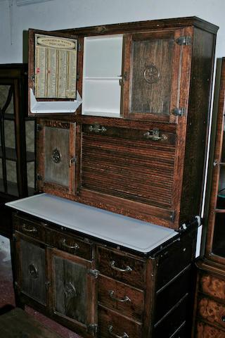 An oak two part kitchen cupboard