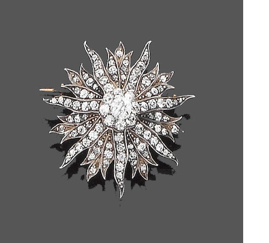 A diamond sunburst brooch/pendant,