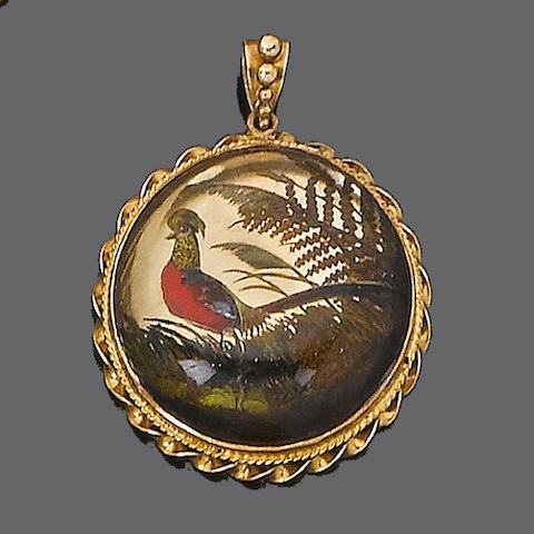 A late 19th century rock crystal reverse intaglio pendant