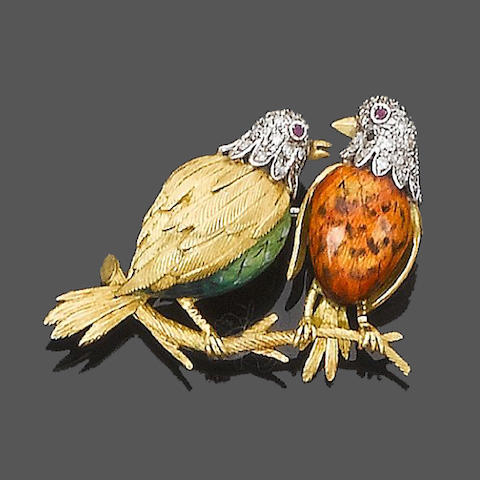 An enamel, diamond and ruby brooch