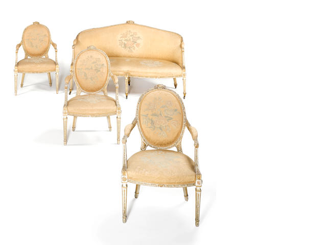 A important and rare George III white painted and parcel gilt Salon Suite comprising of twelve open