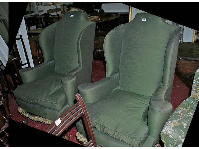 A pair of 20th Century shaped wing back armchairs,