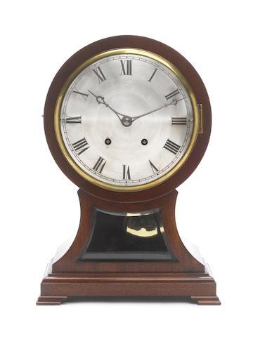 An early 20th century continental mahogany quarter striking balloon clock Winterhalder & Hoffmeier