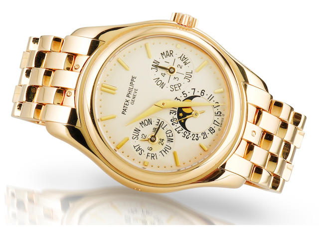 Patek Philippe. A fine and rare 18ct gold perpetual calendar automatic wristwatch Ref: 5136J, Case no. 3126610, Circa 2005