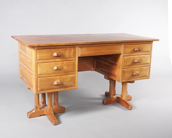 A Hugh Birkett walnut twin pedestal desk, circa 1961