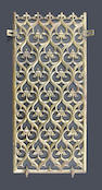 An important Gothic revival cast and pierced brass rectangular interior door grille