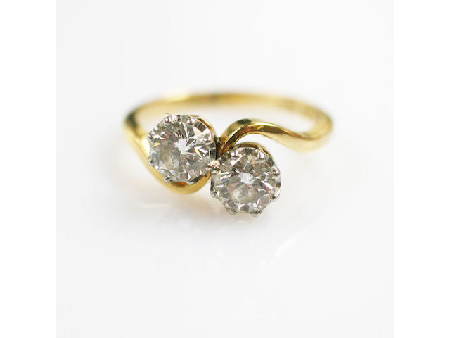 A diamond two stone crossover ring